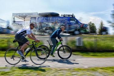 two men riding their bikes