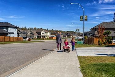 young family walking the neighbourhood
