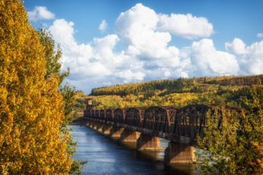 train bridge between trees in autumn